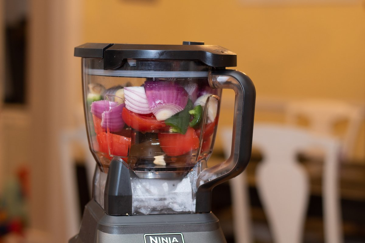 Salsa ingredients in the food processor bowl