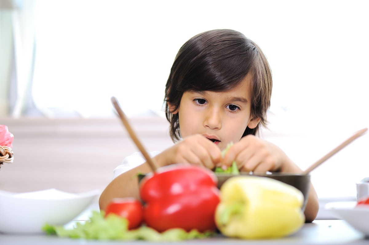 Toddler eating fruit and vegetables