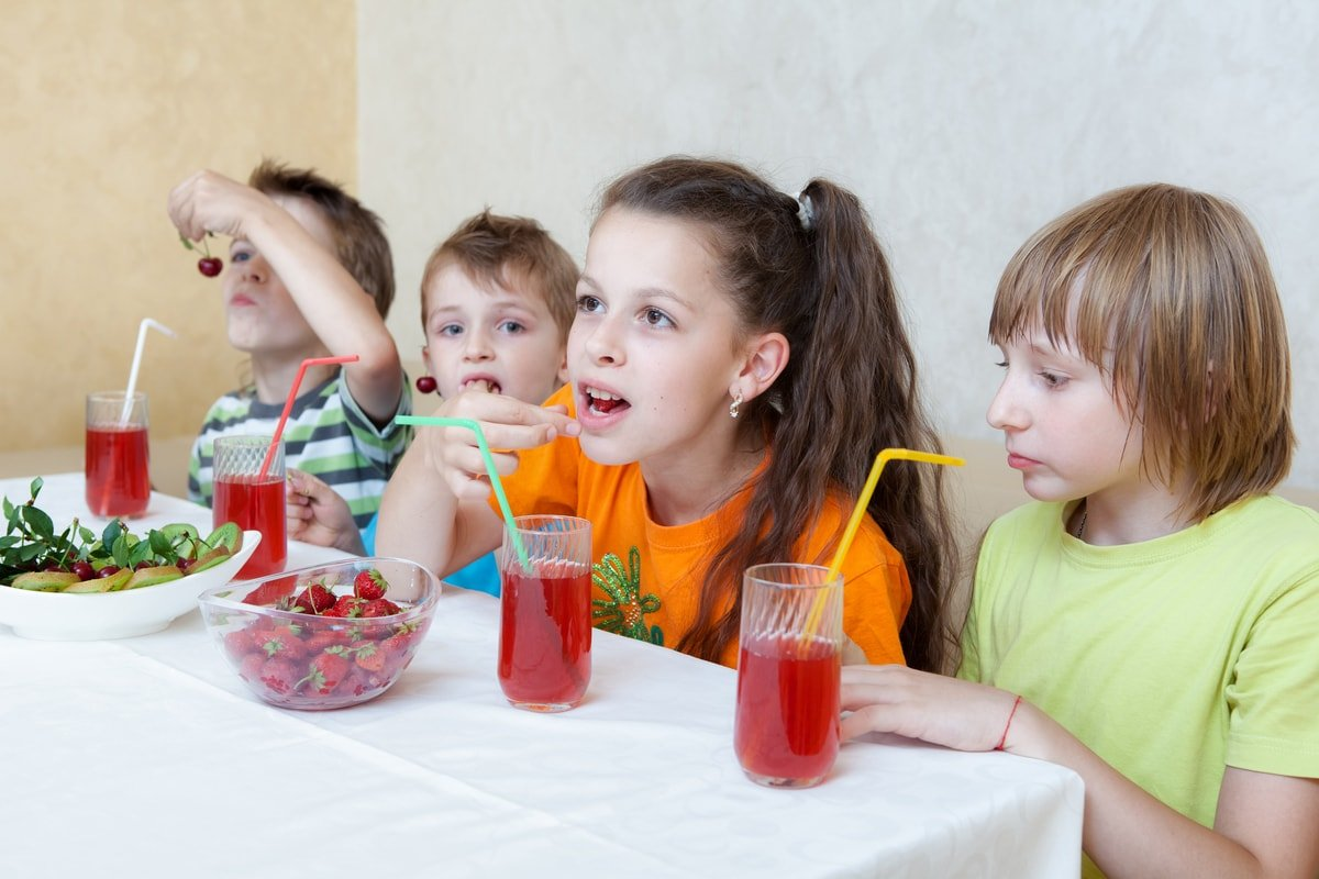 Kids drinking fresh squeezed fruit juice
