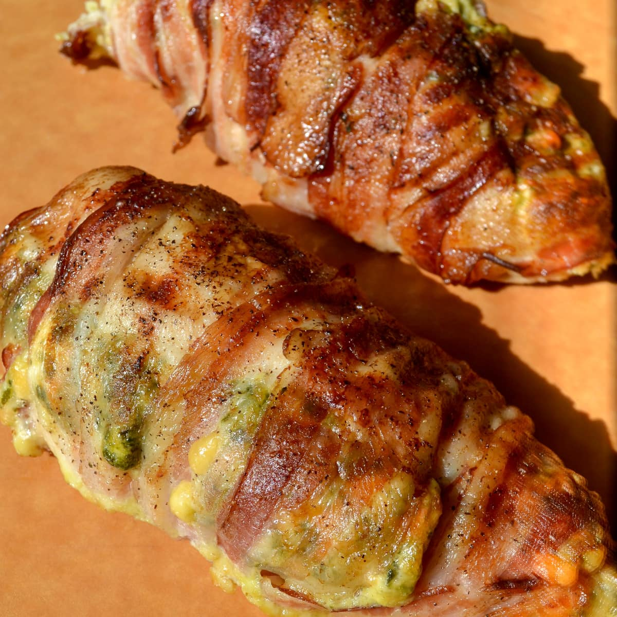 Freshly baked bacon-wrapped cream cheese chicken