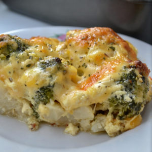 A slice of Cheesy Broccoli Cauliflower Bake