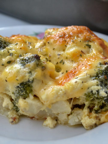A slice of Cheesy Broccoli Cauliflower Bake