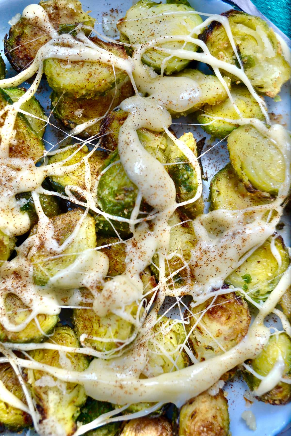 Keto Air Fryer Garlic Brussels Sprouts served with spicy sauce