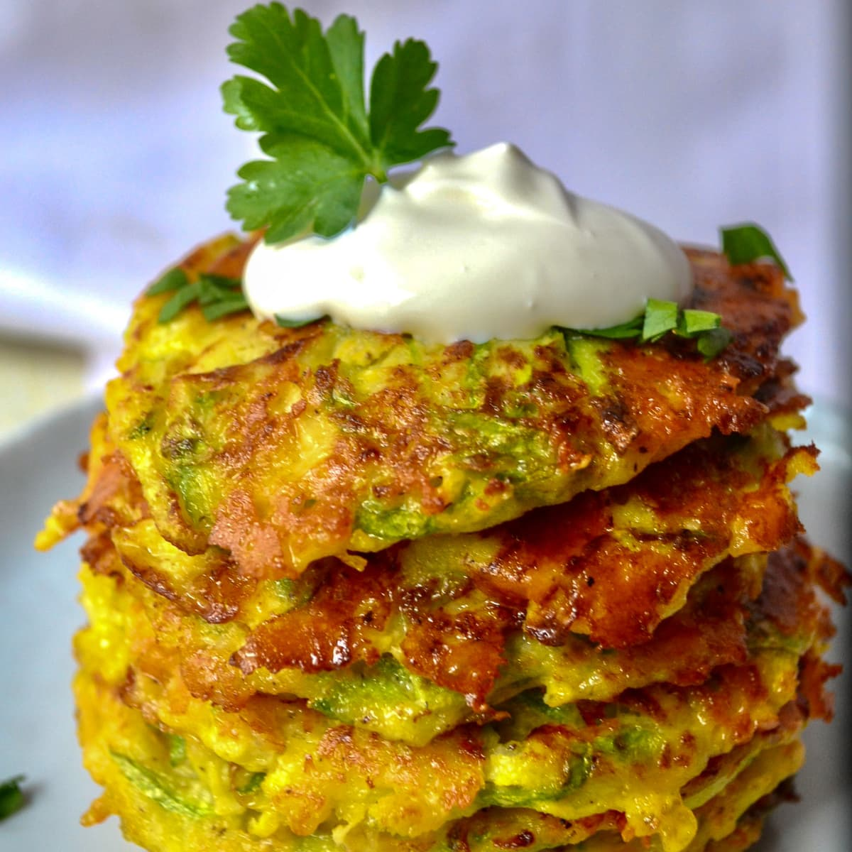 Keto zucchini fritters stacked