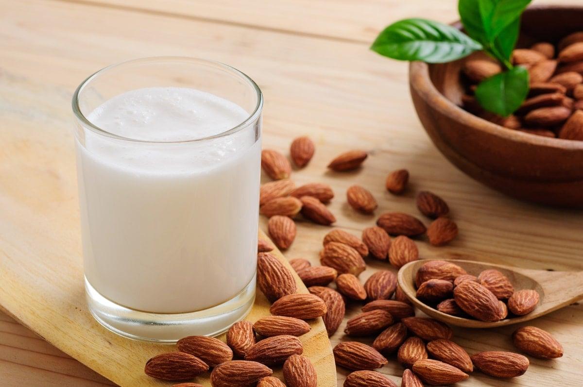 Almond milk on wooden table