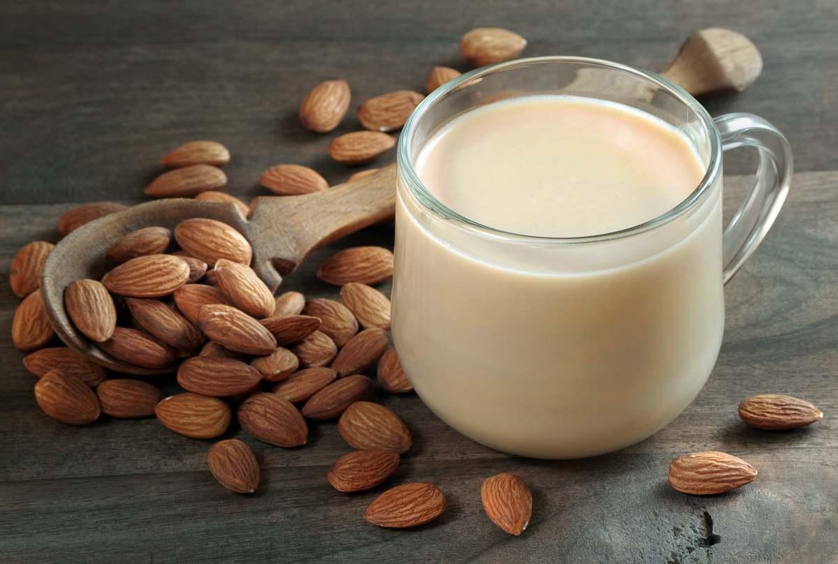 Almond milk on gray table