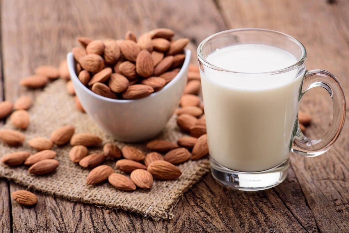 Almond milk on brown wooden table