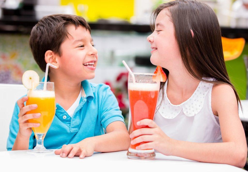 Healthy Kids Drinking Fresh Juice