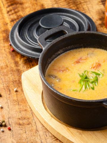 cast iron sauce pot with soup