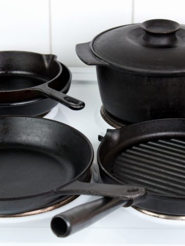 Different cast iron cookware on electric stove