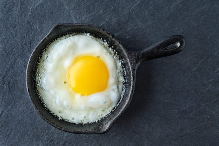 Top view of fried egg in small cast-iron skillet
