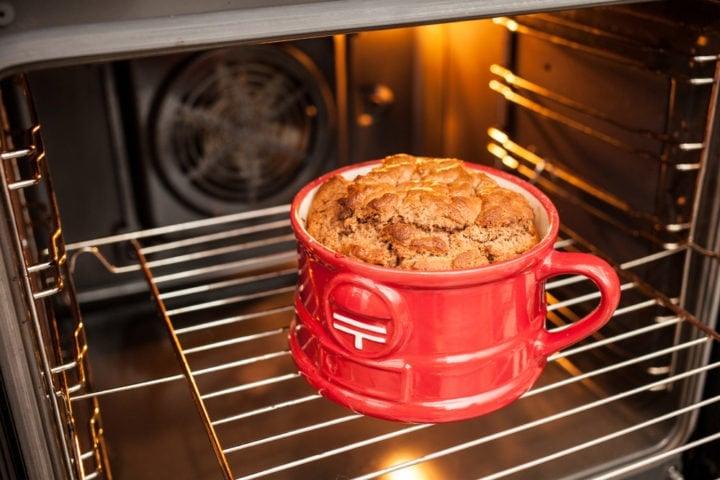 yummy mugcake in a red porcelain mug inside the oven
