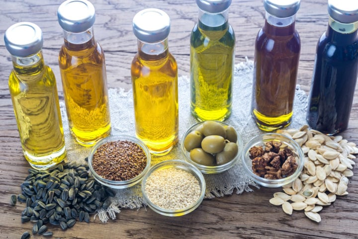bottles of different healthy vegetable cooking oils