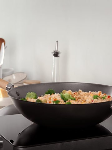 wok cooking on top of an electric stove